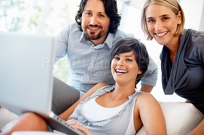 Buy stock photo Beautiful young woman with team working on laptop