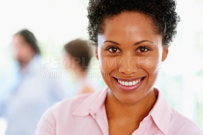 Buy stock photo Attractive woman with group in background