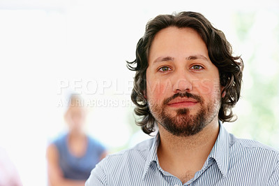 Buy stock photo Focus on thoughtful man with people in background