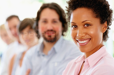 Buy stock photo Focus on woman with team in row in background
