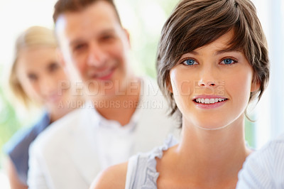 Buy stock photo Focus on woman with group in row in background
