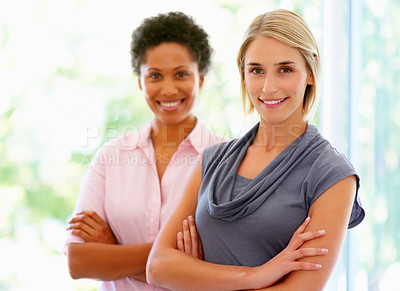 Buy stock photo Two women standing with arms crossed