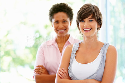 Buy stock photo Focus on woman in front with woman standing behind her