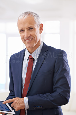 Buy stock photo Shot of a mature businessman smailing happily while gesturing at his tablet