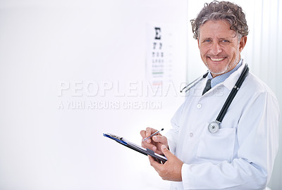 Buy stock photo Portrait of a mature optometrist standing in front of an eye chart