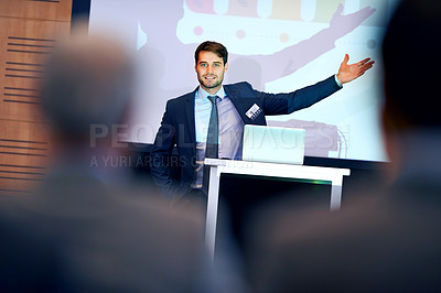Buy stock photo A confident businessman gesturing while giving a presentation at a press conference