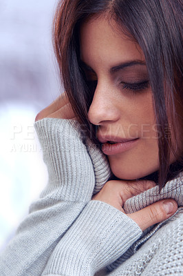 Buy stock photo Cropped shot of a beautiful brunette looking demure in winter