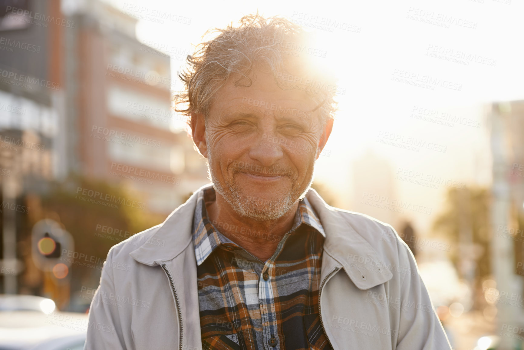 Buy stock photo Portrait of a friendly-looking middle aged man outside