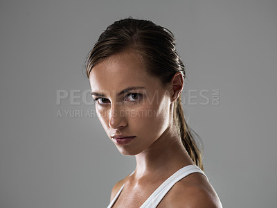 Buy stock photo Portrait of an attractive young woman looking confident