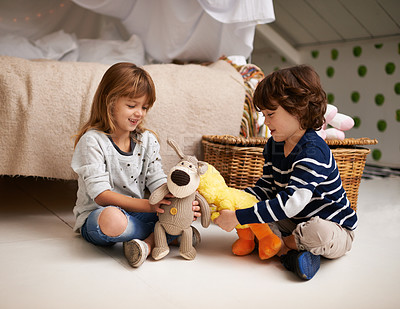 Buy stock photo Shot of two adorable siblings playing together with their stuffed animals