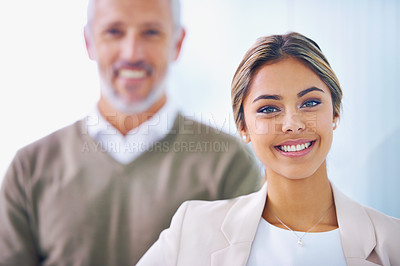 Buy stock photo Portrait of a confident young businesswoman with her coworker standing behind her