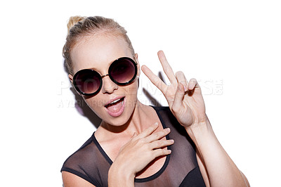 Buy stock photo Portrait of an attractive young woman wearing sunglasses showing the peace sign