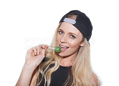Buy stock photo Shot of a rebellious young woman wearing a cap posing with a lollipop in her mouth