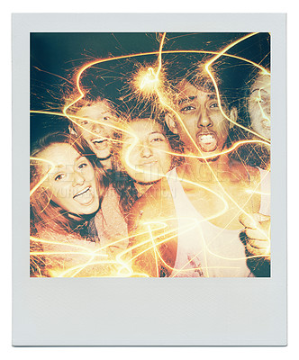 Buy stock photo Shot of teenagers playing with sparklers at night