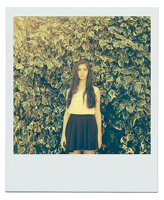 Buy stock photo Portrait of an attractive teenage girl standing in the outdoors