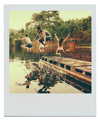 Buy stock photo Shot of a group of teenage friends jumping off a pier into a lake