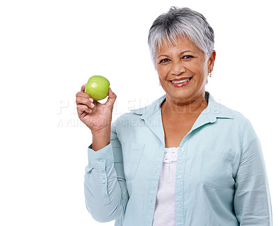 Buy stock photo Studio shot of a mature woman holding an apple isolated on white