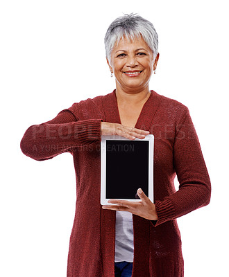 Buy stock photo Studio shot of a mature woman holding a digital tablet isolated on white