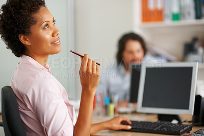 Buy stock photo Thoughtful business woman holding pencil with colleague in blur