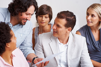 Buy stock photo Happy business man holding paper with his team at office