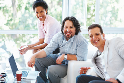 Buy stock photo Young business people smiling together in front of laptop