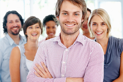 Buy stock photo Handsome young business man with his supporting team in background