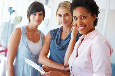 Buy stock photo Multi ethnic business team of three women smiling positively at the camera