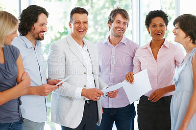 Buy stock photo Successful business man smiling with his team in office