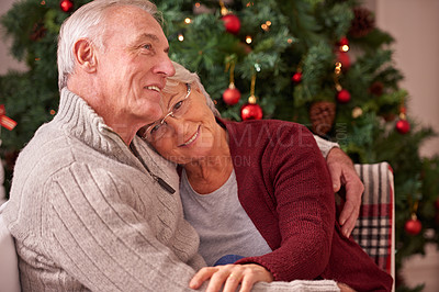 Buy stock photo Shot of a couple sharing christmas together at home