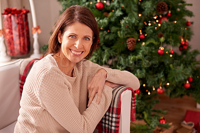 Buy stock photo Shot of a young woman at home on christmas