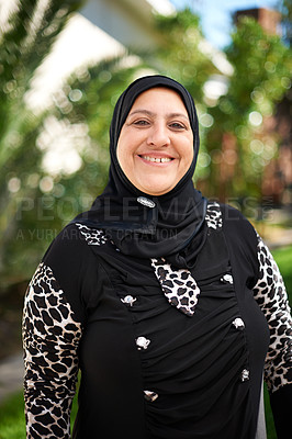 Buy stock photo Portrait of a mature muslim woman standing outside