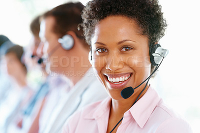 Buy stock photo Young female executive wearing headset and smiling