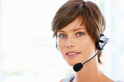 Buy stock photo Closeup of young call center employee wearing headset on white background