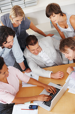 Buy stock photo Top view of business woman working on laptop with team looking at her work