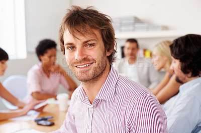 Buy stock photo Happy young man taking break from business meeting