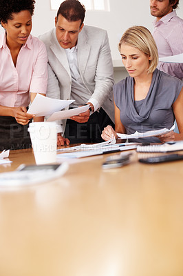 Buy stock photo People looking at business plan and brainstorming