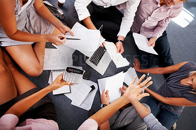 Buy stock photo Cropped view of business people calculating budget in meeting