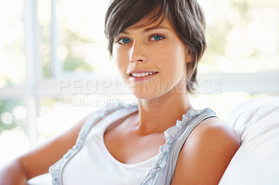 Buy stock photo Closeup of beautiful young woman sitting on sofa at home