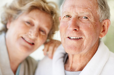 Buy stock photo Closeup portrait of a smiling elderly couple