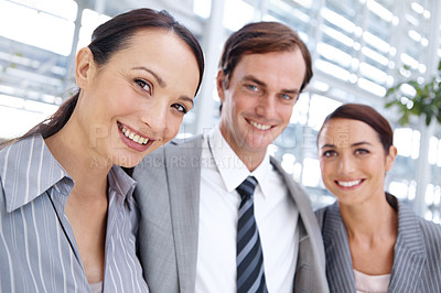 Buy stock photo Three office coworkers standing together and smiling - portrait