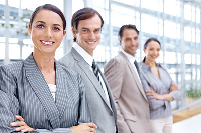 Buy stock photo Portrait of a positive business team smiling while standing together