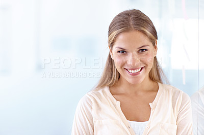Buy stock photo Portrait of a gorgeous young woman smiling at the camera - copyspace