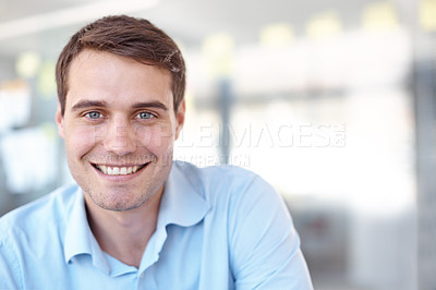 Buy stock photo Handsome young casual businessman smiling at the camera - copyspace