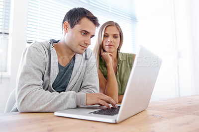 Buy stock photo Two students doing research on a laptop - copyspace