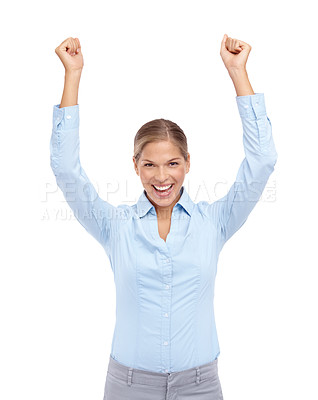 Buy stock photo Excited young woman smiling with her hands in the air