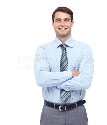 Buy stock photo Smiling young businessman standing with his arms folded