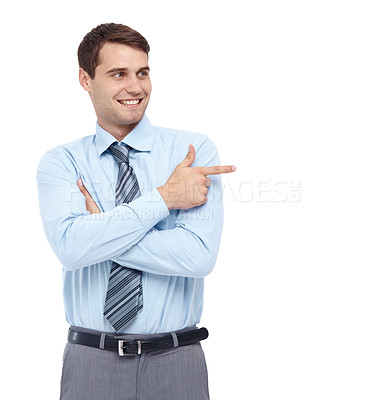 Buy stock photo Young businessman smiling and pointing to the side