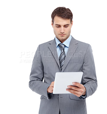 Buy stock photo Handsome young man inspecting a document - isolated