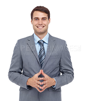Buy stock photo Handsome young businessman smiling while holding his hands together