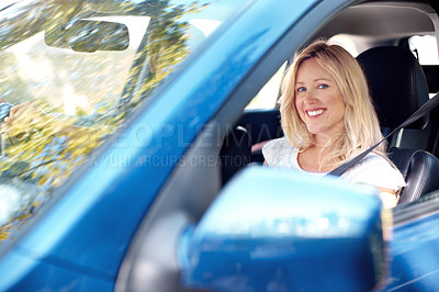 Buy stock photo Portrait of a pretty woman sitting in the passenger seat while her husband drives